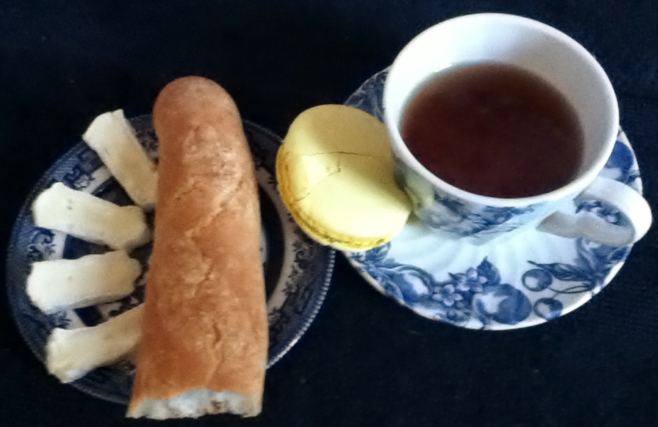 Black tea, lemon macaroon, baguette and brie cheese